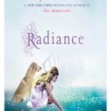Radiance cover: a young women with long hair and a loose dress kneels beside a labrador retriever in a hazy field of seeding flowers. The background is likewise misty with a bridge enshrouded in fog.