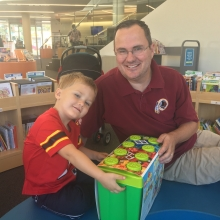 Winner of our Birth-5 Raffle for Duplo blocks, 3/12 year old Ethan, with his father Robert