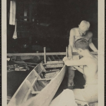 Two workmen building a rowing boat, date unknown