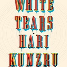 White Tears cover- title and author text in front of a record
