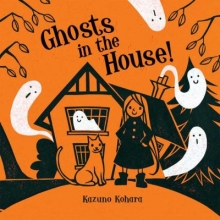 Ghosts in the house cover : A little girl and her cat in front of a haunted house overflowing with ghosts