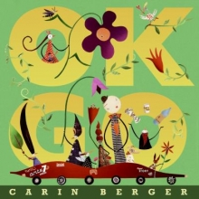 OK go cover. Large text of OK go with a collage family riding in a car and decorative flowers nearby.