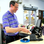 Photo of David Belsky at the Cleveland Park Library Circulation Desk