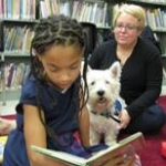 Photo of Pablo listening to a story at the library