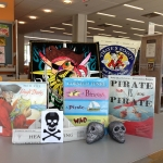 Pirate party books, snacks, and decorations