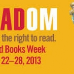 Banned book week logo. Image of statue of liberty with book in hand