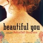 Book cover shows the freckled, tattooed back of a young woman with red hair.