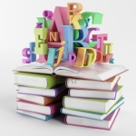 Image of bright, colorful letters atop piles of books