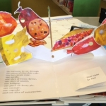 A pop-up scene from the Very Hungry Caterpillar by Eric Carle.