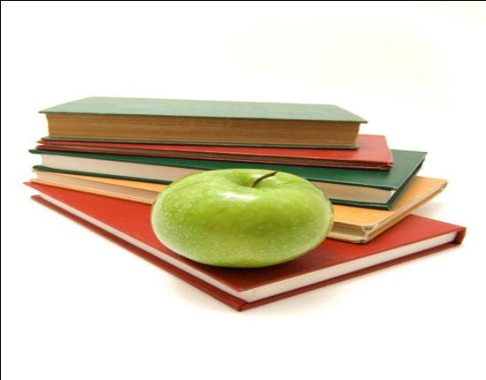 photo of books with a green apple